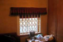 small concertina security window shutter in bedroom