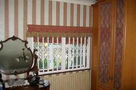 concertina window shutters in bedroom