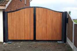 large timber gate with metal frame
