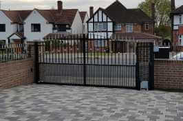 electric residential security gate with matching railings