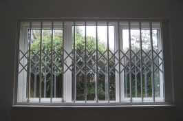 large window with lattice shutters in front