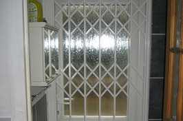 pvc door with lattice shutters