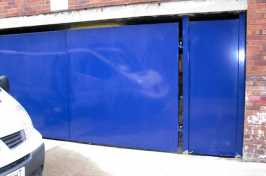 blue block commercial gate with side gate entrance
