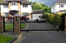 electric driveway gate with matching side gate and intercom system