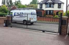 long electric driveway gate with Eales van parked in front