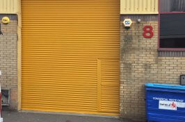 yellow security shutters with access door