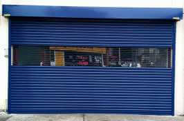 security shutters with portcullis grille inset