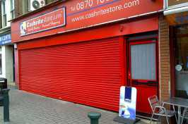 cashrite store front red roller shutters