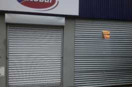 autobar commercial walk in and drive in entrance with roller shutters