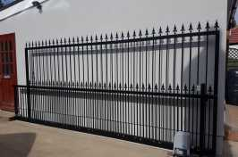 Automated sliding gate made by Eales Shutters