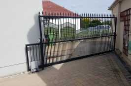Automated sliding gate by Eales Shutters
